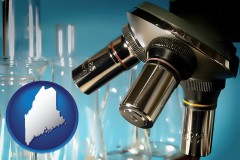 maine a microscope and glassware in a research laboratory
