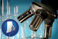 rhode-island map icon and a microscope and glassware in a research laboratory