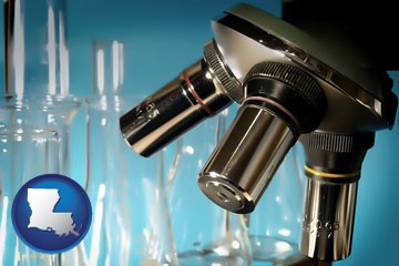 a microscope and glassware in a research laboratory - with Louisiana icon