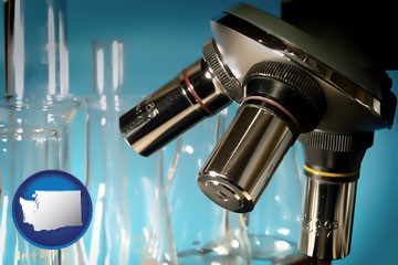 a microscope and glassware in a research laboratory - with Washington icon